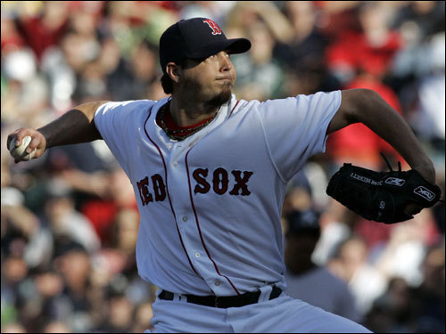 Josh Beckett delivered, in a shadow that covered the infield, delivered a pitch in the fourth inning.