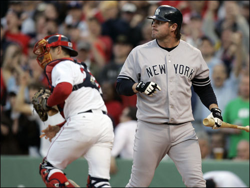Jason Giambi (right) reacted to striking out to end the Yankees threat and seventh inning.