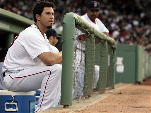 Josh Beckett looked on from the dugout after being taken out of the game.