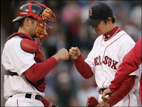 Jason Varitek (left) congratulated Hideki Okajima (right) after striking out Jason Giambi to end the seventh inning.