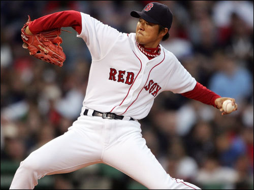 Hideki Okajima delivered a pitch to Robinson Cano in the eighth inning. Okajima would get Cano to ground to second base.