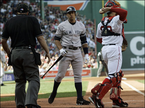 Alex Rodriguez (center) reacts turned to argue with home plate umpire Bob Davidson after striking out in the first inning.