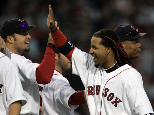Manny Ramirez (right) celebrated with Eric Hinske (left) after the Red Sox win.