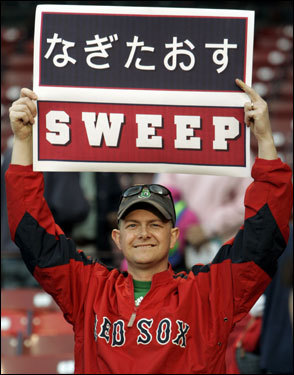 A Red Sox fan held up a sign reading 'sweep' in Japanese and English.