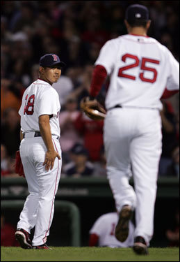 Matsuzaka (left) looked back at Mike Lowell (right) after Lowell made the final out of the second inning.