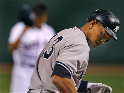 Alex Rodriguez headed to first base as Dice-K tipped his cap.