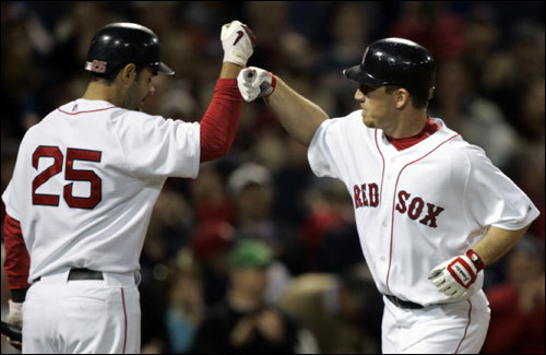 Mike Lowell (left) congratulated J.D. Drew (right) after Drew hit a solo home run in the third inning. Lowell would hit a third straight home run off of the Yankees Chase Wright (not pictured).