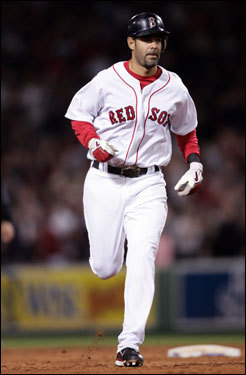 Mike Lowell rounded the bases after his solo home run.