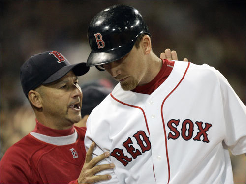 Red Sox manager Terry Francona congratulated J.D. Drew after his home run.
