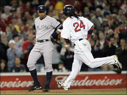 Manny Ramirez (24) passed Alex Rodriguez on the way to home plate following his solo home run in the third inning.