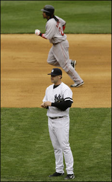 Ramirez (top) rounded the bases as Yankees reliever Sean Henn walked to the mound after Ramirez's eighth-inning two-run home run.