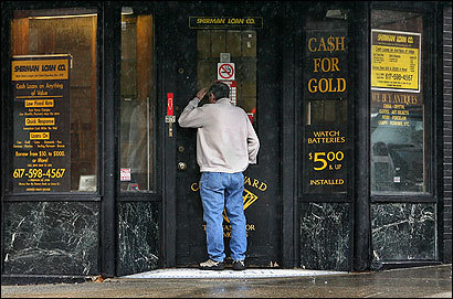 A man looked into a Lynn pawnshop where a 10 percent monthly fee is reportedly charged.
