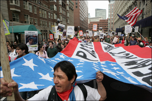 Roberto Quezado, a native of El Salvador, marched down St. James Street during one of many nationwide immigration marches May 1.