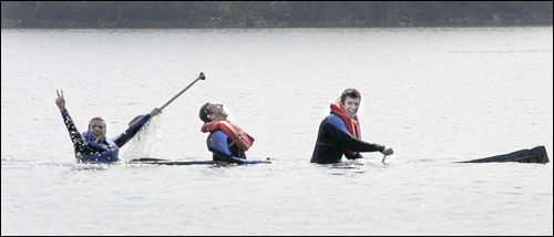 During the 2007 Northeast Regional Concrete Canoe Competition, 12 colleges and universities competed in five events. This crew of three men from Northeastern University got to go for a swim in Lake Cochituate after their canoe, named the USS Goldie, sank during the men's endurance race.