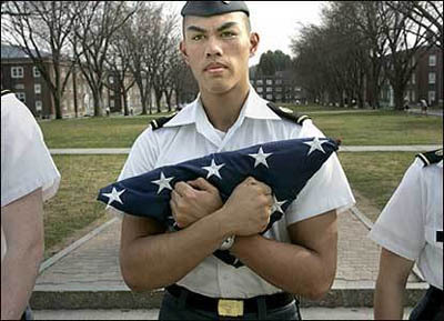 Norwich Cadet Private Kevin Corpuz carries in the flag at 5 p.m. during the daily ritual.