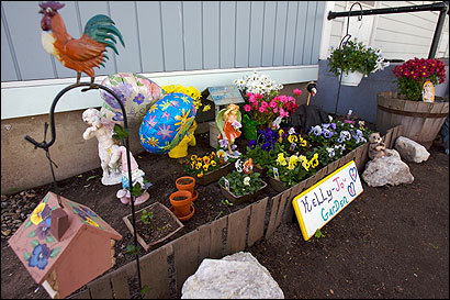 A small garden at the home of Karen Scovil in Malden memorializes her niece, Kelly Jo Griffen, 24, who died at the state prison in Framingham in July of 2003.