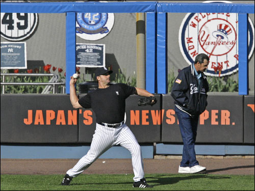 Clemens, left, threw in the outfield as New York Yankees pitching coach Ron Guidry stood in the background after the Yankees' 5-0 victory over the Mariners at Yankee Stadium.