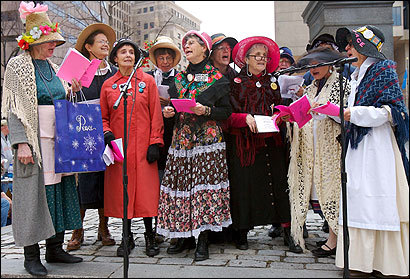 Urging that President Bush be impeached, members of the Raging Grannies, Boston chapter, sang near Faneuil Hall April 28.