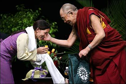 The Dalai Lama patted Yangzom, after a traditional greeting during his visit to Smith College.