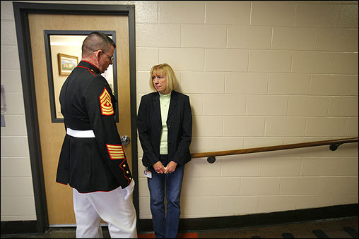 Paul Jornet, a senior Marine instructor at the Montachusett Regional Vocational Technical School in Fitchburg, spoke with school guidance counselor Jean Derocher-Mullins May 4 about the recent death of 2001 graduate Ryan Jones. At least 54 Massachusetts natives have been killed in Iraq since combat operations began in 2003.