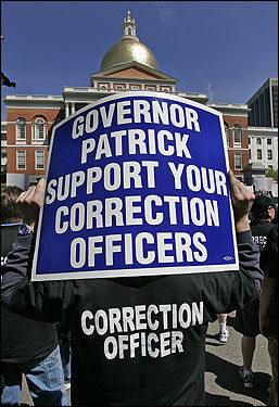 Tim Lynch, holding a sign, rallied with other members of the Massachusetts Correction Officers Federated Union outside the State House Tuesday to protest the state's reluctance to offer a fair contract settlement during ongoing labor negotiations.