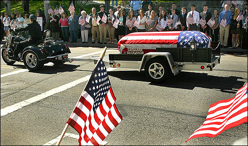 Students from Oliver Ames High School and others stood along Main Street in Easton and held American flags Tuesday as they watched the funeral procession for fallen Marine Sergeant William Callahan. A motorcycle pulled the casket containing Callahan--who was killed in Iraq's Al-Anbar province--to his funeral service at the Immaculate Conception Church.