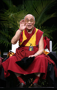 The Dalai Lama waved during his speech Wednesday at Smith College in Northampton, which was organized by Smith and Hampshire colleges and the Tibetan Association of Western Massachusetts. Thousands turned out for the event, and several others watched a simulcast of the event in which the Tibetan spiritual leader responded to preselected questions at the college's Indoor Track and Tennis facility.