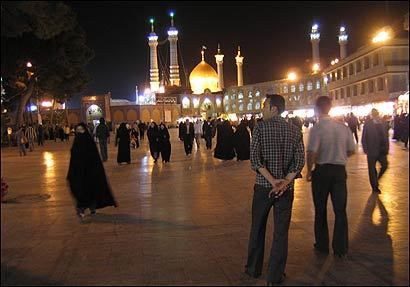 The main square and bazaar outside Qom's shrine in Iran bustles even late at night, a time when Iraqis at home would be afraid to go outside.