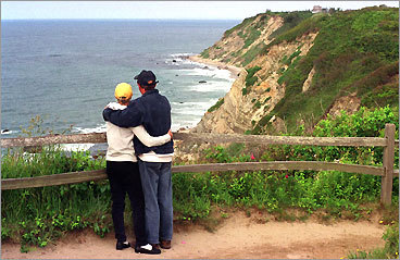 Barbara Gavin and Dennis McCorkle of Irvington, NY look at Mohegan Bluff from Payne's Overlook on Block Island