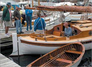 Class members craft boats at various stages of completion.