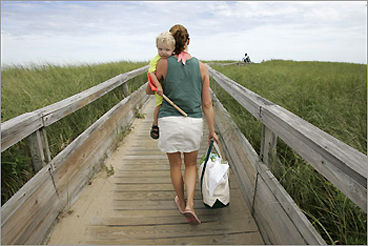 Owen, age 2, and his mother, Amy Roberts, head for the beach on the boardwalk at Parking Lot 1 on the Parker River National Wildlife Refuge on Plum Island.