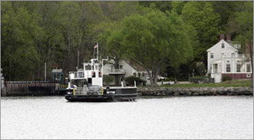 The Chester-Hadlyme ferry leaves the Hadlyme side of the Connecticut River with a load of cars and passengers crossing the river. The ferry, which first went into service in 1769, is the second oldest ferry service operating on the Connecticut River.