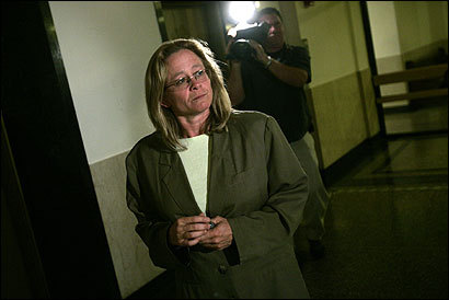 Louise Wightman left Suffolk Superior Court in Boston yesterday after receiving a six-month jail sentence, suspended for five years, for convictions on charges of larceny, filing false healthcare claims, and posing as a psychologist. The former Combat Zone stripper apologized ''for any harm I've done.'' Prosecutors had asked for a prison term of 2-1/2 years.