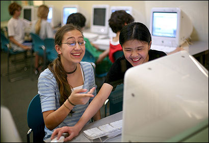 Nancy Chomitz (left) and Christine Leung, both 12, used Scratch to create a project at Clarke Middle School in Lexington. The programming language is being released today.