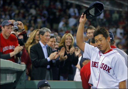 Daisuke Matsuzaka saluted the cheering crowd as he left the field after his complete-game victory. Among those applauding were team owners John Henry and Tom Werner, in the background at left.