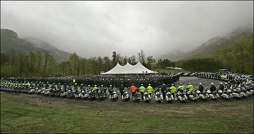 Franconia Officer Bruce McKay's funeral Thursday service drew at least 2,000 police officers from across New England, who marched in the cold rain on Route 18 toward Echo Lake, at the bottom of foggy Cannon Mountain, where mourners gathered. McKay was killed last Friday, when 24-year-old Liko Kenney gunned down the officer after a traffic stop.   Story