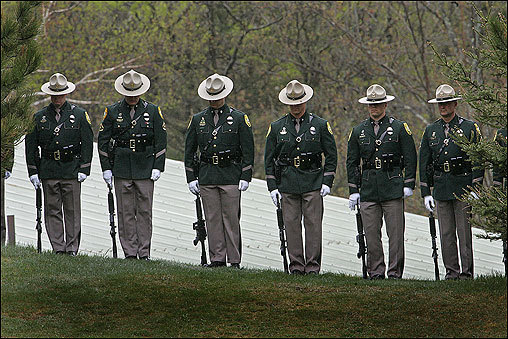 The N.H. State Police Honor Guard readied for a 21-gun salute at McKay's service. The 48-year-old father of one will be cremated during a private service for his family.