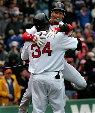 Red Sox shortstop Julio Lugo got a hug from David Ortiz after Lugo's leadoff HR in the first inning.