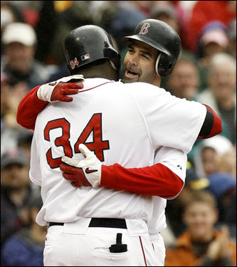 David Ortiz hugged Mike Lowell after Lowell's grand slam in the fifth inning.