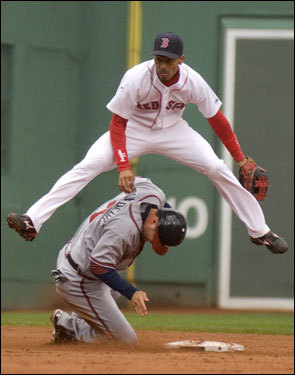 Julio Lugo jumped over Jeff Francoeur while completing a double play in the fifth inning.