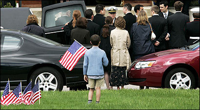 Aram Donabed, 9, of Westwood watched yesterday as the casket of First Lieutenant Andrew J. Bacevich was removed from a hearse to be brought into St. Timothy Church in Norwood for his funeral service. He was killed in Iraq by a suicide bomber.