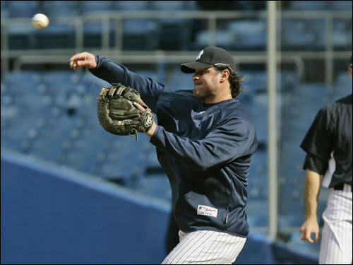 Jason Giambi took fielding practice prior to the game against the Red Sox.