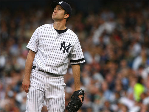 Mike Mussina watched the flight of Ramirez's first inning home run.
