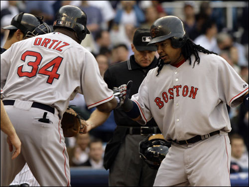 David Ortiz (left) congratulated Manny Ramirez (right) after Ramirez hit a home run in the first inning.