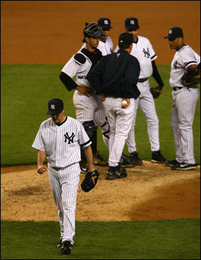 Mike Mussina walked off the mound after giving up three runs in the seventh inning. Mussina allowed seven earned runs in 6 2/3 innings.
