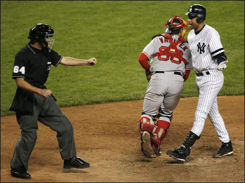 Yankees captain Derek Jeter (right) protested as Red Sox catcher Jason Veritek (33) headed for the mound after umpire Ed Hickox (left) called Jeter out on strikes with two runners on base to end the game.