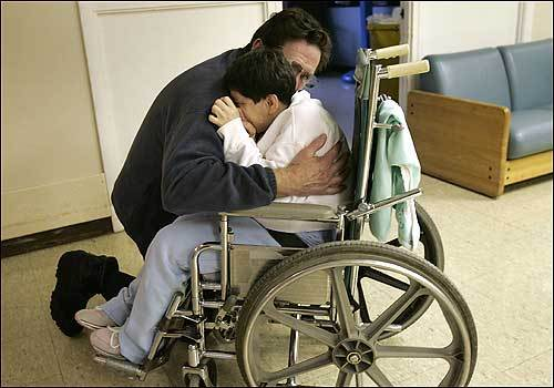 Joan Hanlon gets a hug goodbye from her father, Bob.
