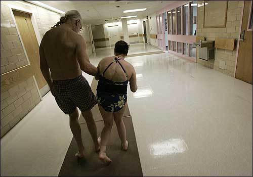 Ed Moran helps Jean Hanlon to the pool at the Fernald Development Center.