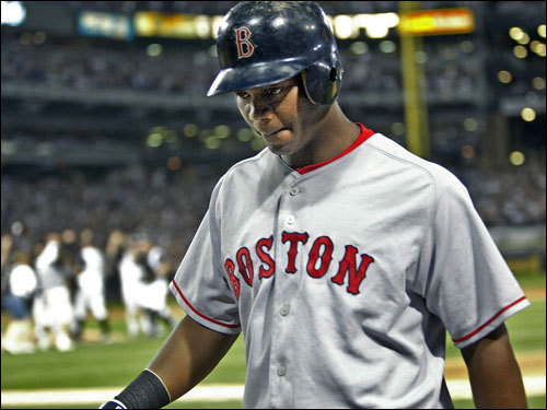 In this October 5, 2005 photo, the White Sox celebrated in the background as Red Sox shortstop Edgar Renteria walked off the field dejectedly after grounding out for the final out of the White Sox' 5-4 victory in Game 2 of the '05 ALDS playoff. In the '05 offseason, the Red Sox agreed to pay $11 million of the $29 million remaining on his contract when he was dealt to the Braves.