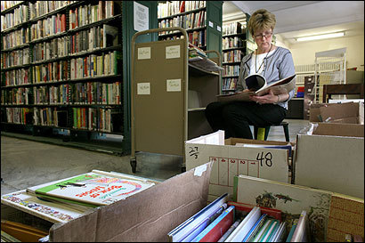 Whitinsville Social Library assistant Marcia Nichols sorted through older children's books that could be